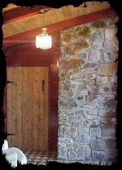 Stone fireplace and hand-hewn oak door